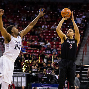 09 March 2018: San Diego State men's basketball takes on Nevada in the quarterfinal round of the Mountain West Conference Tournament. San Diego State Aztecs guard Trey Kell (3) attempts a three point shot with Nevada Wolf Pack guard Jordan Caroline (24) leaping towards him in the first half. The Aztecs cruise past the Wolfpack 90-73 to move on to the Championship game tomorrow afternoon at 3pm.<br /> More game action at www.sdsuaztecphotos.com