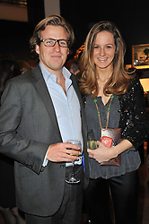 HARRY & CHARLOTTE LAWSON-JOHNSTON at a party to celebrate the publication of The irish Country House written by The Knight of Glin and James Peill with photographs by James Fennell, held at Christie's, King Street, London on 24th January 2011.