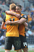 Hull City midfielder Jake Livermore (14) and Hull City midfielder Sam Clucas (11) at the end of  the Sky Bet Championship match between Hull City and Rotherham United at the KC Stadium, Kingston upon Hull, England on 7 May 2016. Photo by Ian Lyall.
