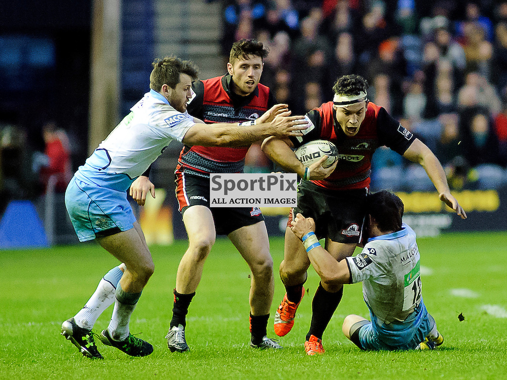 27/12/2015, Murrayfield, Scotland, John HARDIE makes a break desite the efforts of Peter Horne (12) and Tommy Seymour during the Edinburgh Rugby v Glasgow Warriors Guinness PRO12 & 1872 Cup game, ......(c) COLIN LUNN | SportPix.org.uk