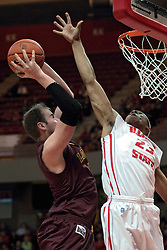11 January 2014: Cody Johnson takes a short jumpshot with Zach Lofton protecting the bucket  during an NCAA  mens basketball game between the Ramblers of Loyola University and the Illinois State Redbirds  in Redbird Arena, Normal IL.  Redbirds win 59-50