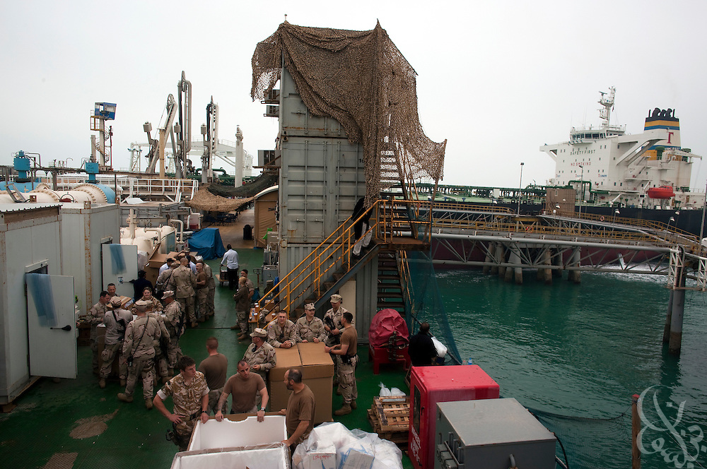 US and UK Sailors and Marines of Combined Task Force (CTF) Iraq Maritime load supplies aboard the Al Basrah oil terminal (ABOT) 50 kilometers off the coast of Iraq in the Northern Arabian Gulf February 3, 2010. CTF Iraq Maritime provides food and logistics for the more than 200 people working on the terminal, as well as providing overwatch security and training for the Iraqi naval and security forces that will eventually take over the responsibility of protecting it as foreign troops prepare to exit Iraq. (Photo by Scott Nelson/Agentur FOCUS)