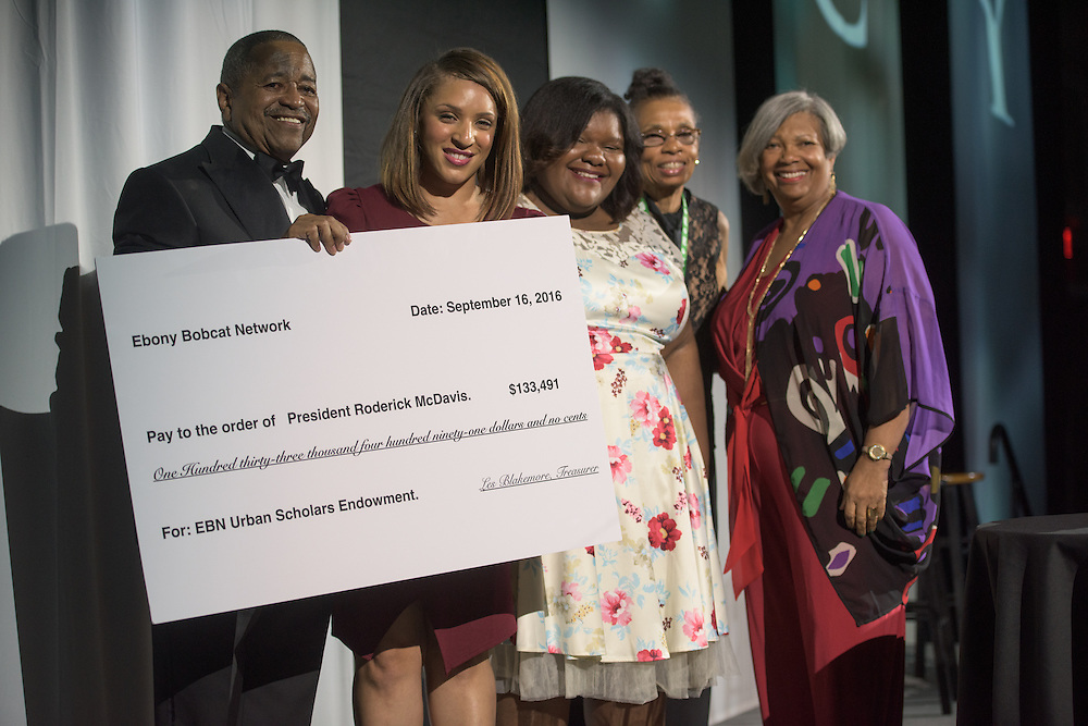 Dr. Roderick McDavis is presented a check for over one-hundred and thirty thousand dollars by the Urban Scholars Endowment Program during Ohio University's 2016 Black Alumni Reunion Gala  in Baker Center Ballroom on Friday, September 16, 2016.