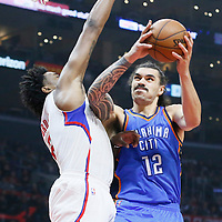21 December 2015: Oklahoma City Thunder center Steven Adams (12) goes for the layup against Los Angeles Clippers center DeAndre Jordan (6) during the Oklahoma City Thunder 100-99 victory over the Los Angeles Clippers, at the Staples Center, Los Angeles, California, USA.