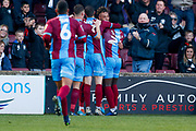 Scunthorpe United forward Kyle Wootton (29) scores a goal and celebrates to make the score 1-1 during the EFL Sky Bet League 1 match between Scunthorpe United and Doncaster Rovers at Glanford Park, Scunthorpe, England on 23 February 2019.