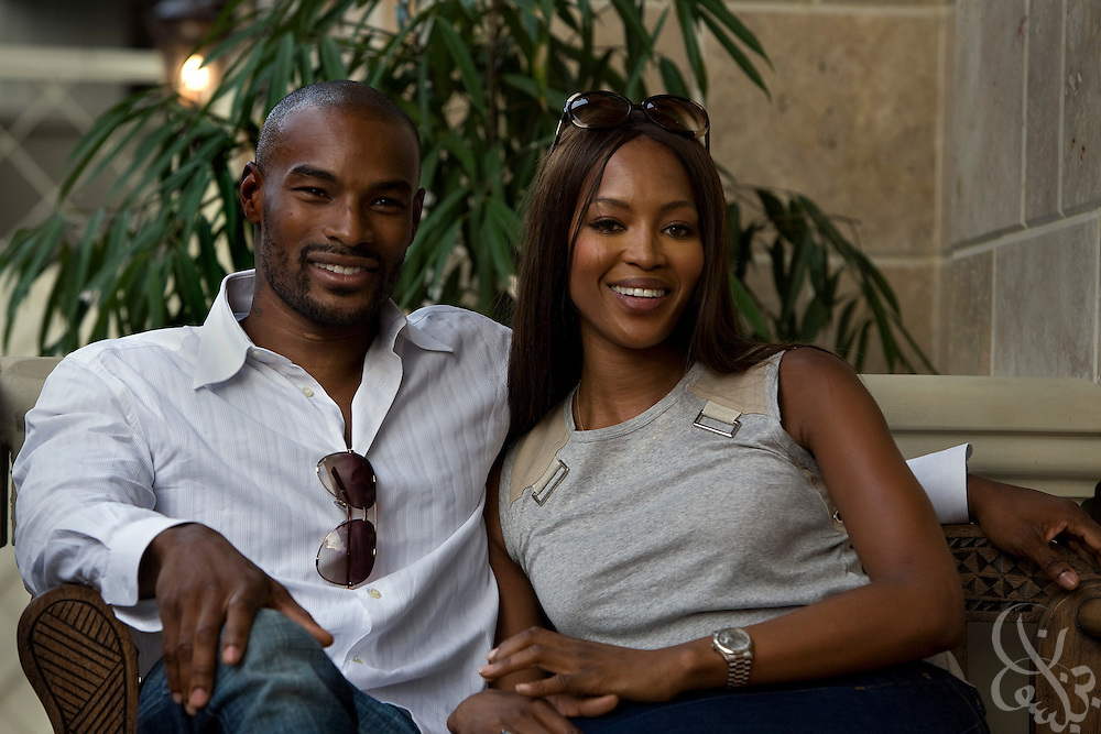 Super models Tyson Beckford (l) and Naomi Campbell pose for photographers in support of the Africa Rising ThisDay music and fashion festival July 13, 2008 in Lagos, Nigeria. The annual music and fashion festival is designed to raise awareness of African issues while promoting positive images of Africa using music, fashion and culture in a series of concerts and events in Nigeria, the United States and the United Kingdom. .