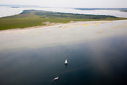 Nederland, Zuid-Holland, Goeree-Overflakkee, 04-07-2006; de Hompelvoet, eiland mede ontstaan door de aanleg van de Brouwersdam (dam aan de horizon, tussen tussen Schouwen-Duiveland (links) en Goeree-Overflakkee (rechts); door de afsluiting van de zee-arm vielen een aantazandplaten permanent droog; het eiland ligt in het Grevelingenmeer, het grootste zoutwatermeer van West Europa; natuurreservaat, broedplaats, rustplaats voor vogels, vogeltrek, waterbeheer, getijden, eb en vloed, Deltawerken, milieu, milieuproblematiek, landschap, natuur, zand, recreatie, pleziervaart, zeilboot, watersport; luchtfoto (toeslag); aerial photo (additional fee required); .foto Siebe Swart / photo Siebe Swart
