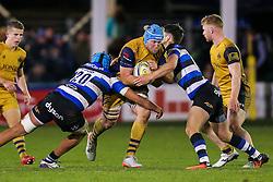 Jordan Crane (capt) of Bristol Rugby is tackled by Zach Mercer of Bath Rugby - Rogan Thomson/JMP - 18/11/2016 - RUGBY UNION - Recreation Ground - Bath, England - Bath Rugby v Bristol Rugby - Aviva Premiership.