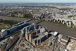 © Licensed to London News Pictures. 26/04/2016. London, UK. The former Battersea Power Station redevelopment is underway. London-based Foster + Partners have designed a building inspired by the 1930s which will be topped by one of the city's largest roof gardens offering spectacular panoramic views of London. The 42-acre site, which is costing £8billion to build, will house 3,992 apartments, three hotels and a riverside park.  Photo credit: Martin Apps/LNP