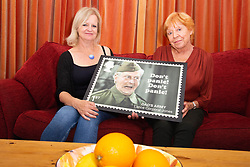 L-R Daughter Jessica Dunn and wife Priscilla Morgan admire a stamp design featuring Dad's Army's Clive Dunn. London, June 04 2018.