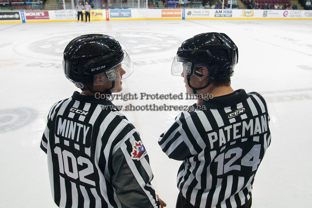 KELOWNA, CANADA - OCTOBER 7: Dustin Minty and Ward Pateman, WHL linesmen, stand on the ice as the Swift Current Broncos visit the Kelowna Rockets on October 7, 2014 at Prospera Place in Kelowna, British Columbia, Canada.  (Photo by Marissa Baecker/Getty Images)  *** Local Caption *** Dustin Minty; Ward Pateman;