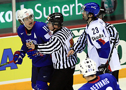Anze Kopitar of Slovenia, referee and Ivan Majesky of Slovakia l at ice-hockey game Slovenia vs Slovakia at second game in  Relegation  Round (group G) of IIHF WC 2008 in Halifax, on May 10, 2008 in Metro Center, Halifax, Nova Scotia, Canada. Slovakia won after penalty shots 4:3.  (Photo by Vid Ponikvar / Sportal Images)