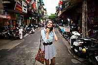 A young woman walks through the narrow alleyways of Hanoi's Old Quarter, in northern Vietnam.