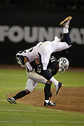 Los Angeles Rams running back Todd Gurley II (30) gets upended as he tries to dive over a tackle attempt by Oakland Raiders defensive back Marcus Gilchrist (31) on a fourth quarter run for a gain of 23 yards and a first down at the Raiders 35 yard line during the 2018 regular season week 1 NFL football game against the Oakland Raiders on Monday, Sept. 10, 2018 in Oakland, Calif. The Rams won the game 33-13. (©Paul Anthony Spinelli)