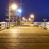 San Clemente pier at night panorama picture. San Clemente is a popular coastal beach city in Orange County California in the United States of America. Panoramic photo ratio is 1;3. Copyright ⓒ 2017 Paul Velgos with All Rights Reserved.