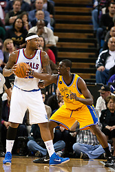 March 14, 2011; Sacramento, CA, USA;  Sacramento Kings power forward DeMarcus Cousins (15) is defended by Golden State Warriors power forward Ekpe Udoh (20) during the first quarter at the Power Balance Pavilion. Sacramento defeated Golden State 129-119.