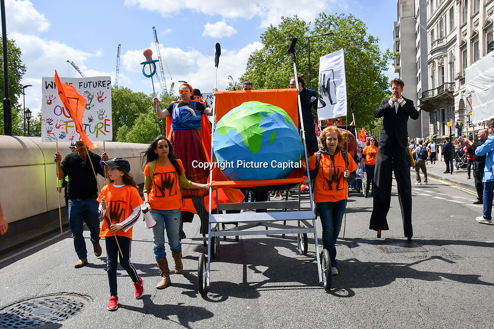 Thousands join Mothers rise up host a Mothers Climate March 2019 in Central London, on 12 May 2019, London, UK