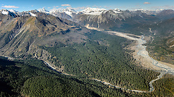A significant portion of the Haines State Forest pictured in this photo is under consideration for harvest. Known as the Baby Brown Timber Sale, the proposal by the Alaska Division of Forestry calls for 1,000 acres (20 million board feet) of Sitka spruce and  western hemlock to be harvested from state land. This photo shows a portion of the Baby Brown Timber Sale area near Haines Alaska between Glacier Creek (bottom), and Jarvis Creek (top). The Klehini River is at the right. Also visible is the Haines Highway (AK-7). The Baby Brown Timber Sale also includes forest land west of Porcupine Creek (not shown).<br /> <br /> The area pictured also shows land that Constantine Metal Resources Ltd. has leased mineral rights. Constantine Metals is also currently exploring the area above Glacier Creek. The minerals that Constantine&rsquo;s drilling explorations have found are primarily copper and zinc, with significant amounts of gold and silver.<br /> <br /> If approved the Baby Brown Timber Sale would be the largest sale in the Chilkat Valley since the 1990&rsquo;s. The Division of Forestry estimates that the sale could generate 20 jobs directly associated with the harvest, $300,000 in royalties to the state. The economic impact of the sale to the statewide economy is estimated to $2,000,000.<br /> <br /> Conservation groups are concerned by the size of the sale and the impact a sale of this size will have on the watershed, fish, and wildlife. There are also concerns about the impact the harvest will have on the viewshed visible from the Haines Highway (AK-7) which has been designated as a National Scenic Byway.