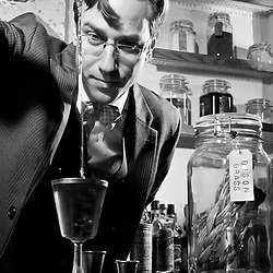 Derek Brown, the mixologist behind the Columbia Room, prepares his 4th Regiment Cocktail, at his 7th St NW bar.  Credit: Susana Raab for The Wall Street Journal