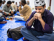 03 JULY 2014 - BANGKOK, THAILAND: A man prays before Iftar, the meal that breaks the day long fast at Haroon Mosque in Bangkok during the holy month of Ramadan. Ramadan is the ninth month of the Islamic calendar, and the month in which Muslims believe the Quran was revealed. The month is spent by Muslims fasting during the daylight hours from dawn to sunset. Fasting during the month of Ramadan is one of the Five Pillars of Islam. Muslims believe that the Quran was sent down during this month, thus being prepared for gradual revelation by Jibraeel (Gabriel) to the prophet Muhammad.     PHOTO BY JACK KURTZ