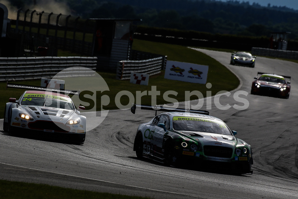 Team Parker Racing Bentley Continental GT3 with drivers Rick Parfitt & Seb Morris leads Macmillan AMR Aston Martin Vantage GT3 with drivers Jack Mitchell & James Littlejohn during the British GT And BRDC British F3 Championships at the Snetterton Circuit, Norwich, England on 28 May 2017. Photo by Jurek Biegus.