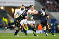 Owen Farrell is stopped by Ruaridh Jackson (R) during the RBS Six Nations match between England and Scotland at Twickenham Stadium, UK, on the 2nd February 2013. (Photo by Andrew Tobin www.slikimages.com)