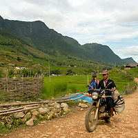 Vietnamese man criging a motorbike a road  at Northern Vietnam