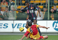 Fotball<br /> Frankrike 2004/05<br /> Lens v Lyon<br /> 6. november 2004<br /> Foto: Digitalsport<br /> NORWAY ONLY<br />  ERIC ABIDAL (LYON) / JACEK BAK (LENS)