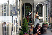 Annapolis, Maryland - April 18, 2015: A double reflection from an open glass door and window show groom Winston Bao Lord, left, waiting by the altar while bridesmaid Hannah North walks during the procession. <br /> <br /> Stephanie Shearer Cate and Winston Bao Lord wed at their friends Jeff and Marry Zients' house in Annapolis, Maryland Saturday April 18, 2015. <br /> <br /> <br /> <br /> CREDIT: Matt Roth for The New York Times<br /> Assignment ID: 30173318A