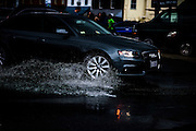 "Annapolis, Maryland - June 05, 2016: An automobile drives through a sizable puddle in front of the Harbor Master's office on Dock Street in Historic Annapolis Sunday June 5th, 2016. The puddle is an example of nuisance flooding and was exacerbated by the morning's perigean spring tide and the afternoon's brief thunderstorm.<br /> <br /> <br /> A perigean spring tide brings nuisance flooding to Annapolis, Md. These phenomena -- colloquially know as a ""King Tides"" -- happen three to four times a year and create the highest tides for coastal areas, except when storms aren't a factor. Annapolis is extremely susceptible to nuisance flooding anyway, but the amount of nuisance flooding has skyrocketed in the last ten years. Scientists point to climate change for this uptick. <br /> <br /> <br /> CREDIT: Matt Roth for The New York Times<br /> Assignment ID: 30191272A"