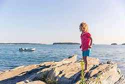 A young girl plays on East Gosling Island in Casco Bay, Harpswell, Maine.