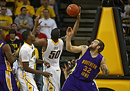 December 07 2010: Iowa Hawkeyes forward Jarryd Cole (50) and Northern Iowa Panthers forward Lucas O'Rear (32) battle for a rebound as Iowa Hawkeyes forward Melsahn Basabe (1) looks on during the first half of their NCAA basketball game at Carver-Hawkeye Arena in Iowa City, Iowa on December 7, 2010. Iowa defeated Northern Iowa 51-39.