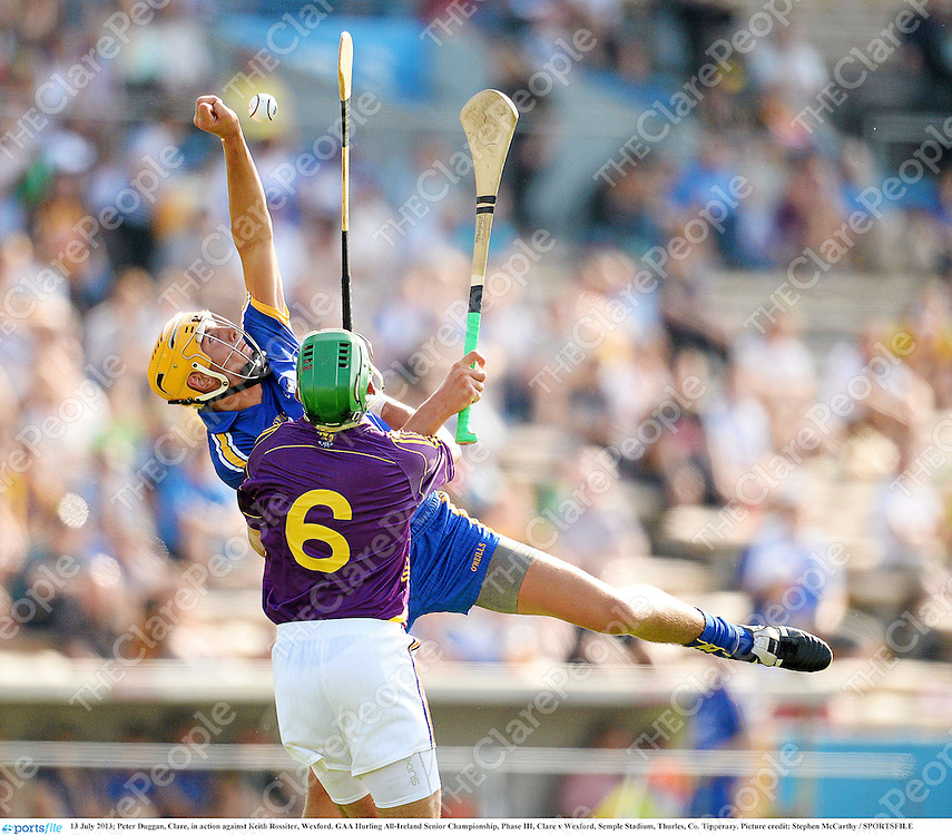13 July 2013; Peter Duggan, Clare, in action against Keith Rossiter, Wexford. GAA Hurling All-Ireland Senior Championship, Phase III, Clare v Wexford, Semple Stadium, Thurles, Co. Tipperary. Picture credit: Stephen McCarthy / SPORTSFILE
