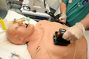 Phil, the OPD (Operating Department Practitioner) is defibrillating a 'Patient Simulator' during a cardiac arrest at the ExPERT Centre, a new wing of the University of Portsmouth, on Wednesday, March 28, 2007, in Portsmouth, England. The 'Patient Simulators' have been built to resist and react to the shock caused by a real defibrillator, they can bleed, breathe, drool and even speak, and are being used by students at the state-of-the-art new training centre. They cost 270.000 USD each and are able to simulate all sort of acute conditions, including heart attacks. The 'Patient Simulators' are housed at a $9 million USD centre which opened few weeks ago. Students and professionals from different health-care disciplines simulates conditions to then act and provide the right treatment, while the 'patient' will react accordingly. www.port.ac.uk/expertcentre  **Italy Out**