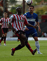 Photo: Tony Oudot.<br /> Brentford v Stockport County. Coca Cola League 2. 29/09/2007.<br /> Adrian Pettigrew of Brentford with Anthony Elding of Stockport