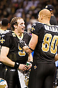 NEW ORLEANS, LA - DECEMBER 26:   Quarterback Drew Brees #9 of the New Orleans Saints is congratulated by Jimmy Graham #80 after Brees throws a nine-yard touchdown pass to running back Darren Sproles #43 and breaks the single-season passing record in the fourth quarter against the Atlanta Falcons at Mercedes-Benz Superdome on December 26, 2011 in New Orleans, Louisiana.  The Saints defeated the Falcons 45-16.  (Photo by Wesley Hitt/Getty Images) *** Local Caption *** Drew Brees; Jimmy Graham