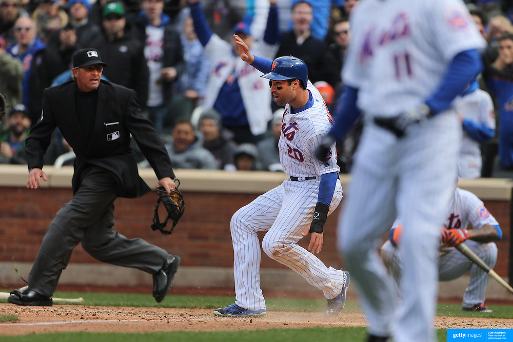 NEW YORK, NEW YORK - APRIL 08: Neil Walker, New York Mets, scores a run during the New York Mets Vs Philadelphia Phillies, Mets home opener at Citi Field on April 8, 2016 in New York City. (Photo by Tim Clayton/Corbis via Getty Images)