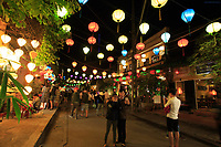 Tourists mix with locals under colourful lanterns in the old town of Hoi An, Vietnam