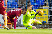 Goalkeeper Mark Gillespie (#20) of Motherwell FC gets to the ball ahead of Tom Aldred (#5) of Motherwell FC during the Ladbrokes Scottish Premiership match between St Johnstone and Motherwell at McDiarmid Stadium, Perth, Scotland on 11 May 2019.
