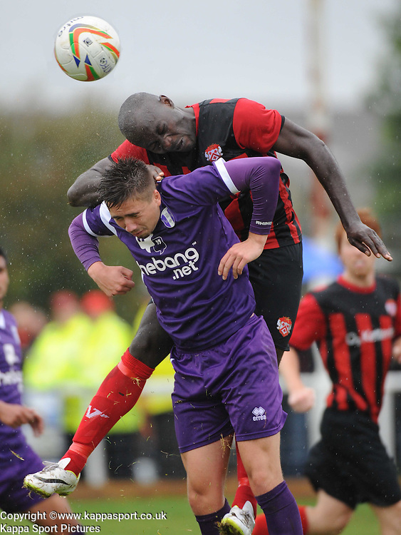 Ketterings Henry Eze Holds of Daventry Jamie Calvin, , Kettering Town v Daventry Town Southern League 25/8/14