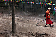 A monk descends from Nanzang Pass  as he circumambulates Kawagarbo, the third-holiest mountain in Tibetan Buddhism, Yunnan, China; September, 2013.