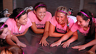 "6 Oct. 2011 -- ST. LOUIS. -- Volleyball players from Bishop DuBourg High School, including Savanna Shatto (5), Kelsie Kiser (15) Alex Wirth (14), Sam Benson (23) and Bridget Hacker (16) do part of their pre-game ritual sporting special pink jerseys before their game with Rosati-Kain High School Thursday, Oct. 6, 2011 at DuBourg in St. Louis. Both teams participated in a ""pink game"" to benefit SSM St. Mary's Health Care Center's Cancer Care, in honor of Rosati-Kain president Sister Joan Andert, SSND, who is currently undergoing treatment for breast cancer. Photo © copyright 2011 Sid Hastings."
