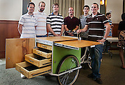Senior Ohio University mechanical engineer students, (from left) Daniel Stockton, Dan Held, Nick Stewart, Grant Honroth, Ryan Lynch and Chris Dodd, pose in front of the tricycle they designed for Logan resident, Cathy Mundy, on Saturday, May 9, in Walter Hall. The tricycle is designed to be easy to pedal through different gradients and carry baked goods in its drawers.