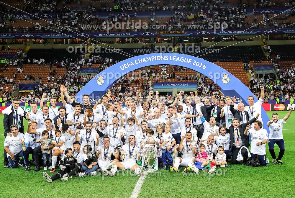 Players of Real Madrid celebrate with a Trophy during Trophy ceremony after winning during the football match between Real Madrid (ESP) and Atlético de Madrid (ESP) in Final of UEFA Champions League 2016, on May 28, 2016 in San Siro Stadium, Milan, Italy. Photo by Vid Ponikvar / Sportida