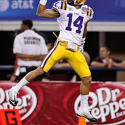 Jan 7, 2011; Arlington, TX, USA; LSU Tigers cornerback Tyrann Mathieu (14) makes a one handed grab during warm ups prior to kickoff of the 2011 Cotton Bowl against the Texas A&M Aggies at Cowboys Stadium. LSU defeated Texas A&M 41-24.  Mandatory Credit: Derick E. Hingle