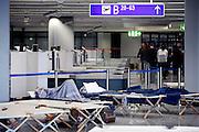 Frankfurt am Main | April 19 2010<br /> Durch eine riesige Aschewolke, die durch einen Ausbruch von Vulkan Eyjafjallajoekull auf Island ausgestossen wurde, kommt der Flugverkehr ueber fast ganz Europa zum Erliegen, etwa 800 Fluggaeste sind im Transit in Terminal 1 gestrandet, sie haben kein Visum und koennen nicht nach Deutschland einreisen. Hier: Gestrandete Passagiere schlafen auf ihren Feldbetten vor den Sicherheitseinrichtungen in Terminal 1. @peter-juelich.com [No Model Release | No Property Release]