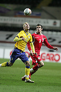 Christian Wilhelmsson of Sweden is challenged by Gareth Bale of Wales. International friendly, Wales v Sweden at the Liberty Stadium in Swansea on Wed 3rd March 2010. pic  by  Andrew Orchard