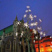 Christmas lights outside Christ Church Cathedral in downtown Montreal. Situated in the heart of the commercial and shopping centre of Montreal, the neo-Gothic building was completed in 1859 and was designed by British architect Frank Wills.
