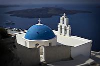 An Orthodox Greek Church with a blue domed roof, Santorini, Greece