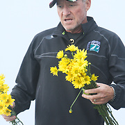 Ed Pierce places flowers Sunday August 3, 2014 to remember his wife Barbara Pierce at the former quarantine station where she lost her life in a boating accident two years ago. (Jason A. Frizzelle)